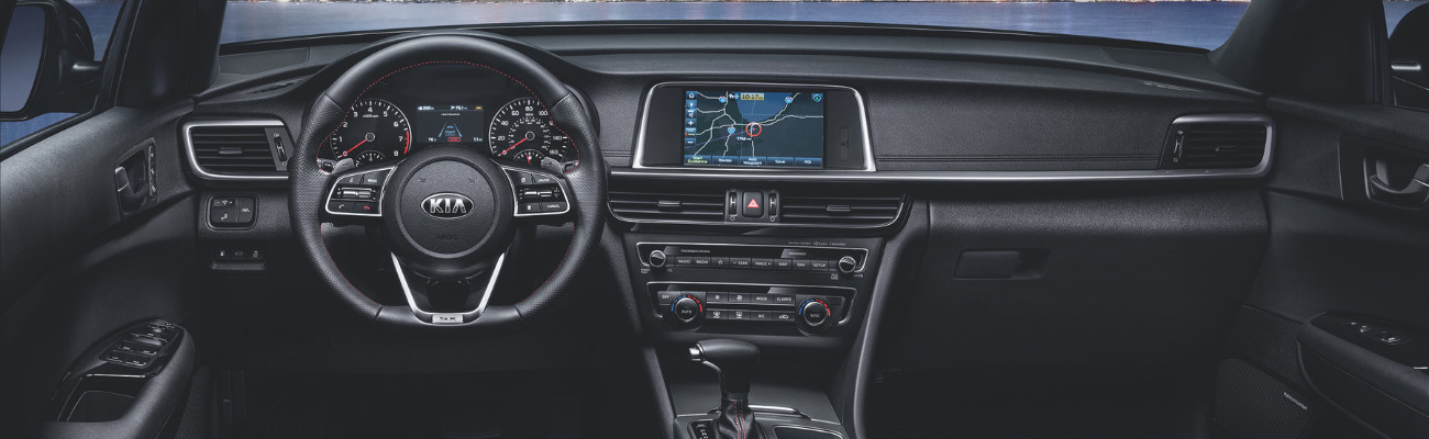 Front interior view of the 2019 Kia Optima SX model in Colorado Springs showing the heated steering wheel and touch screen infotainment system