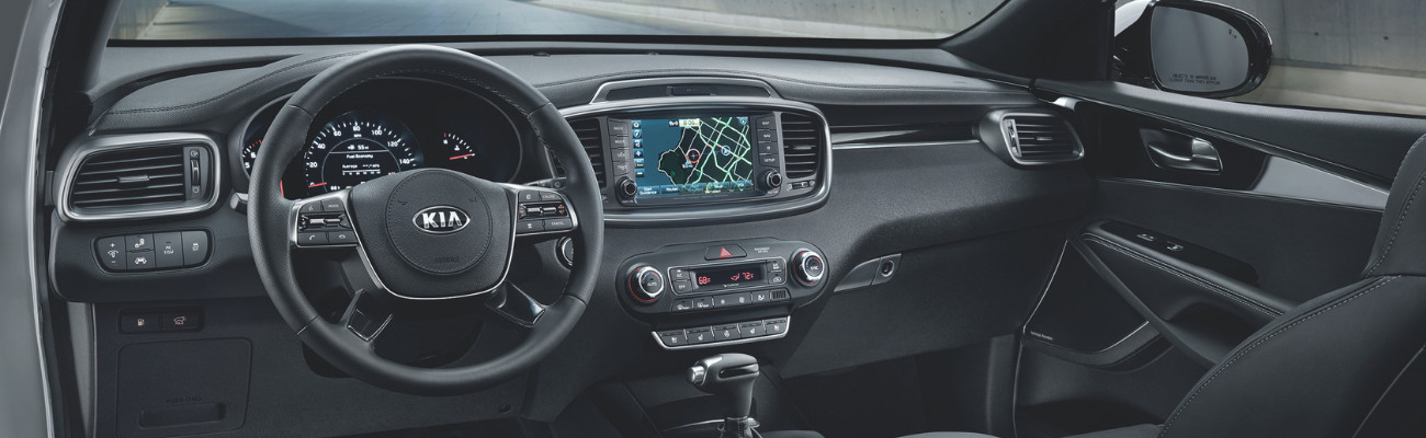A look at the interior of a 2019 Kia Sorento showing the dashboard and navigation system