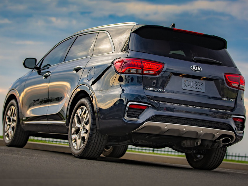 Back Side Exterior of a gray blue 2019 Kia Sorento parked on empty asphault opening