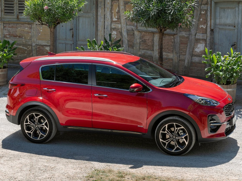 Exterior of a red 2019 Kia Sportage parked in a driveway