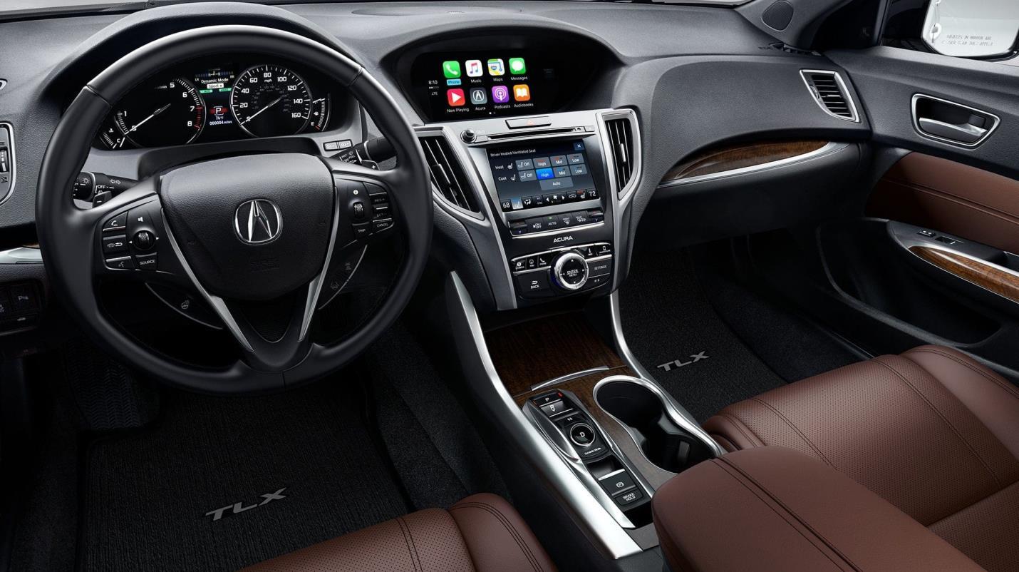 Ten el control absoluto de todo en la cabina del TLX: diseño a la perfección.