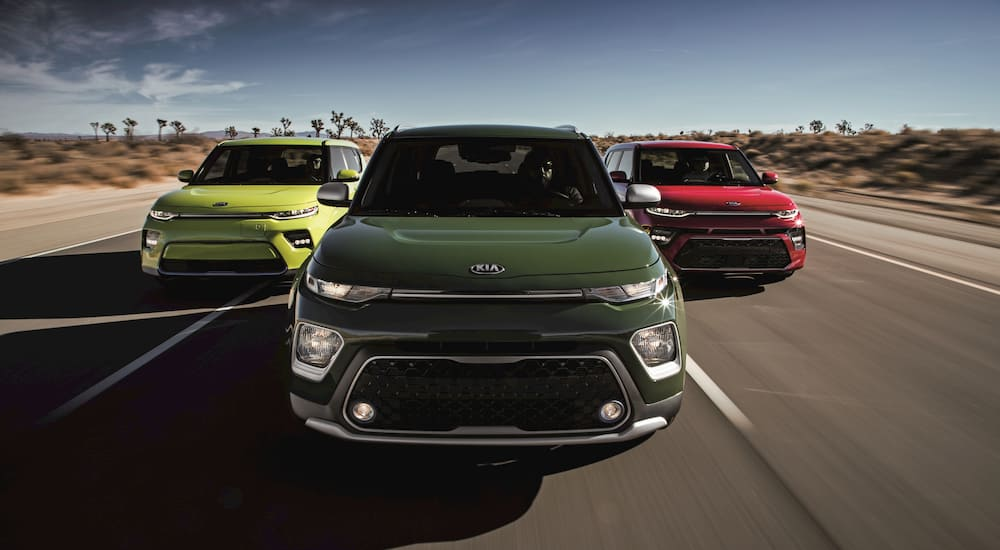 Three colorful Kia's cruise the open highway