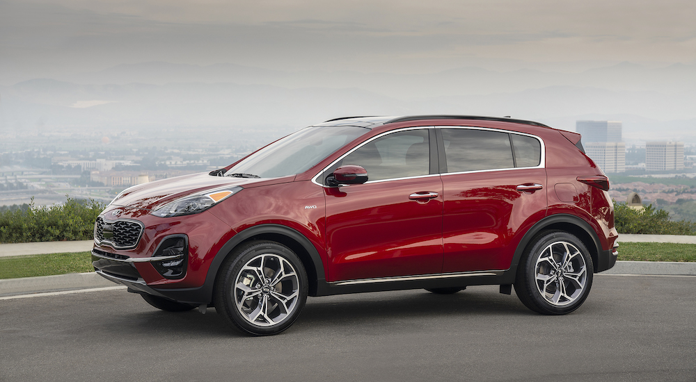 A red 2019 Kia SUV with a local PA city in the background