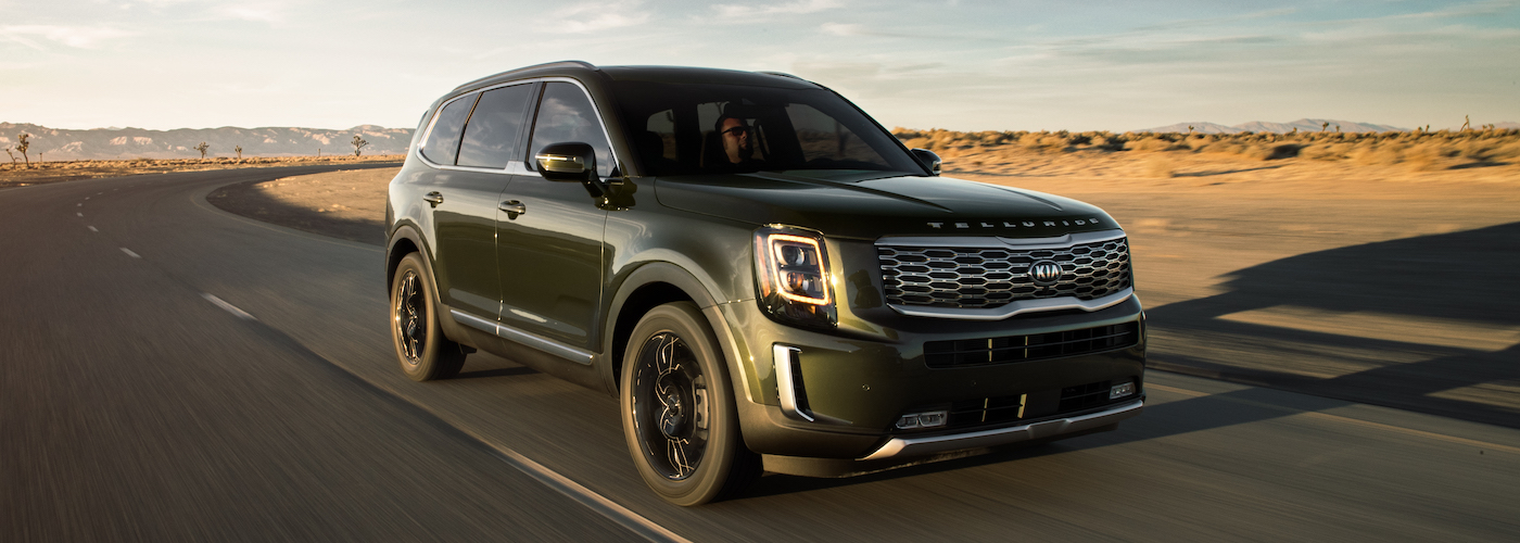 A dark metallic 2020 Kia Telluride on a desert road