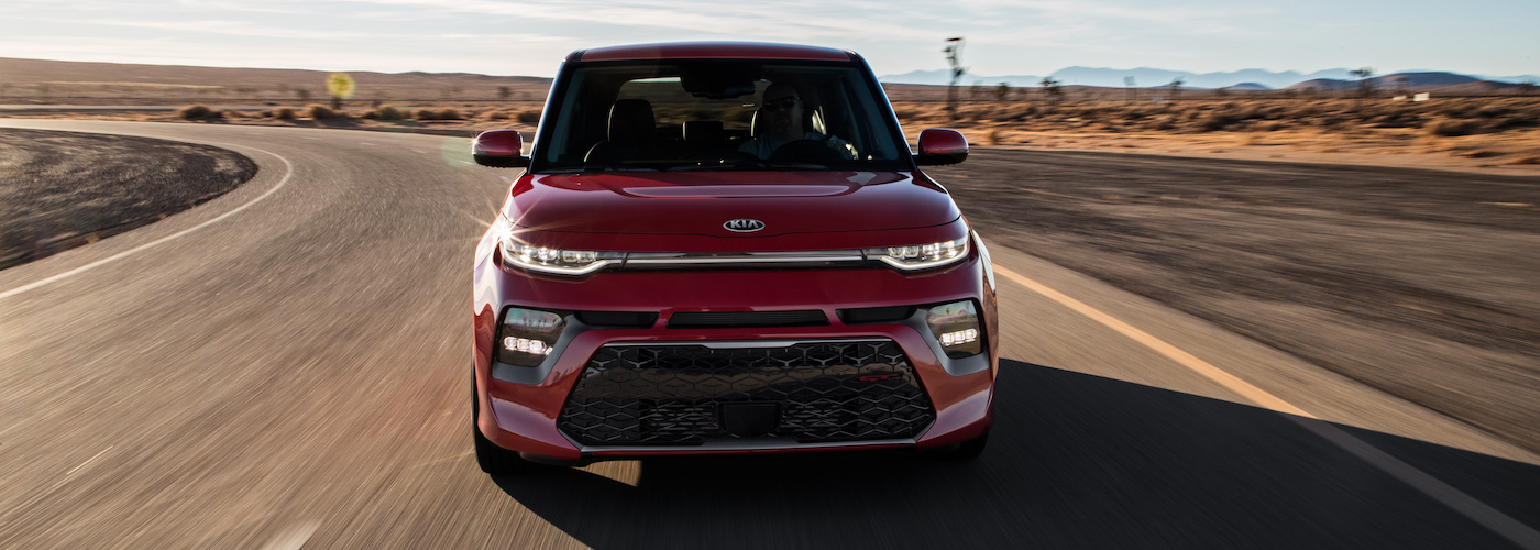 A red 2020 Kia Soul at dusk