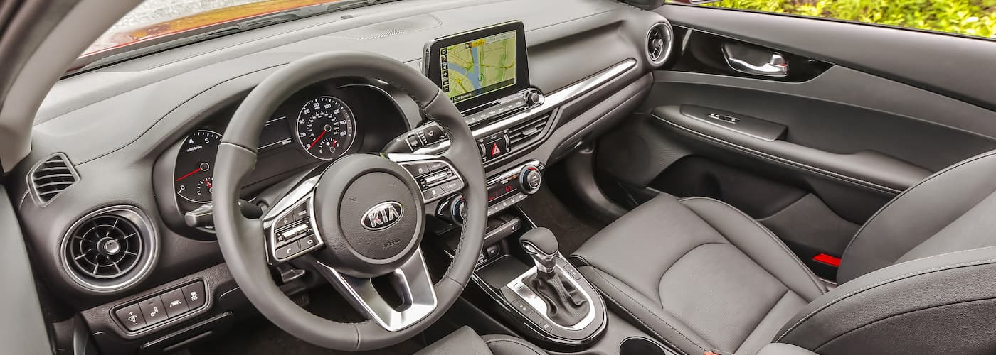 The black interior of a 2020 Kia Forte is shown.