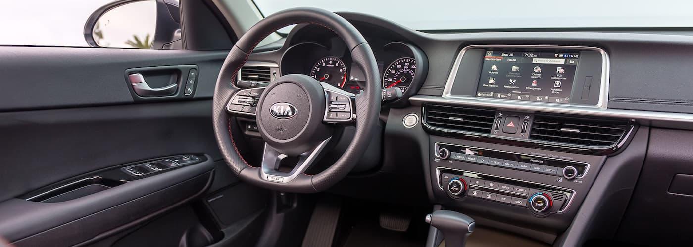 The black interior of a 2020 Kia Optima is shown.
