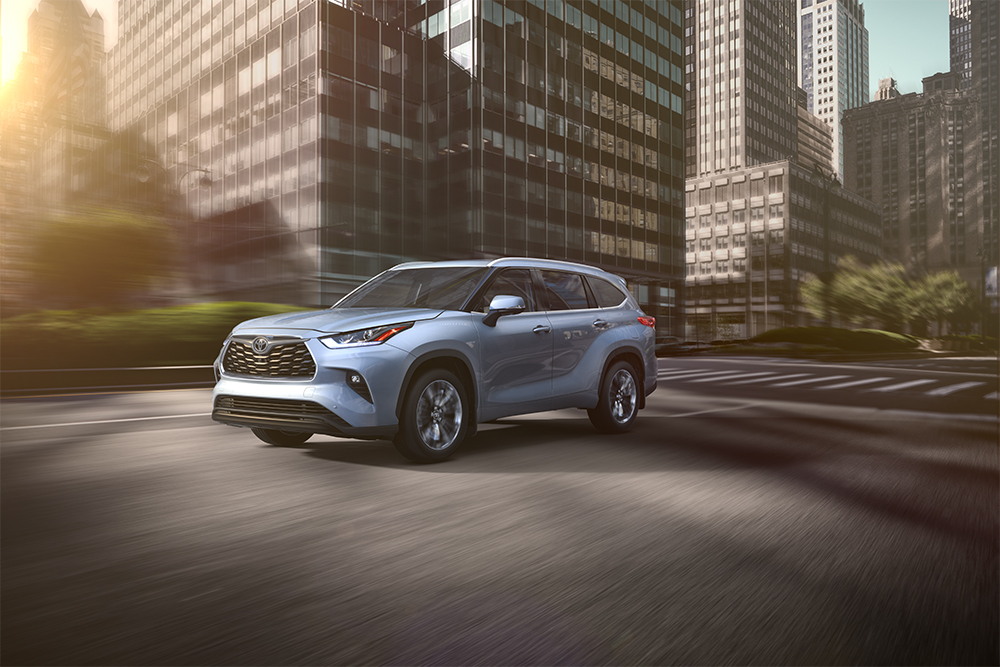 the 2020 Toyota Highlander coming soon to Tri County Toyota of Royersford | Blue 2020 toyota highlander running on road