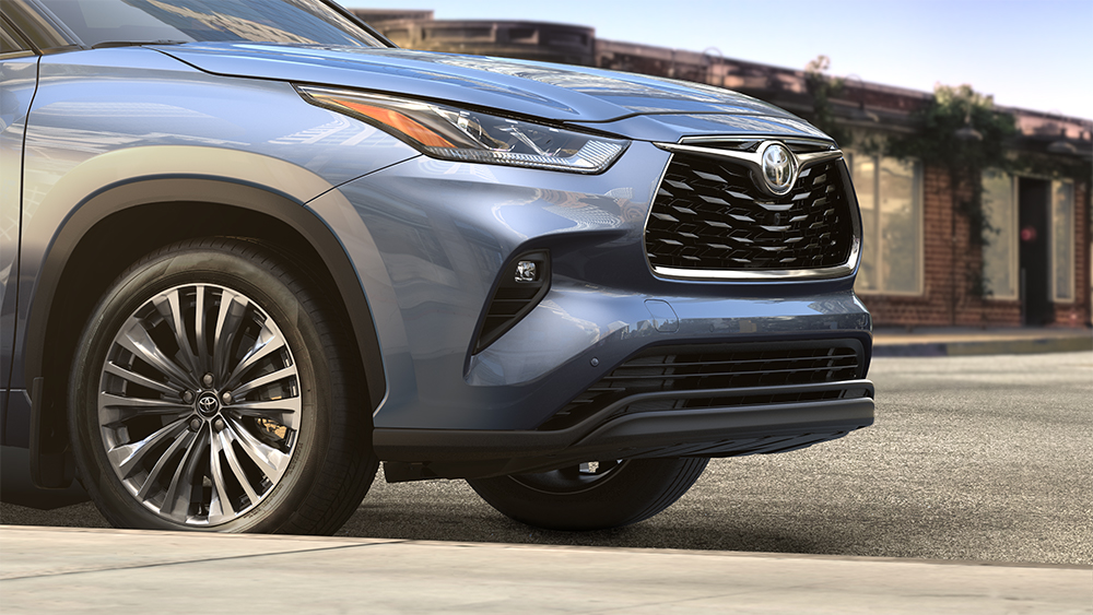 the 2020 Toyota Highlander coming soon to Tri County Toyota of Royersford | Blue 2020 toyota highlander parked on road