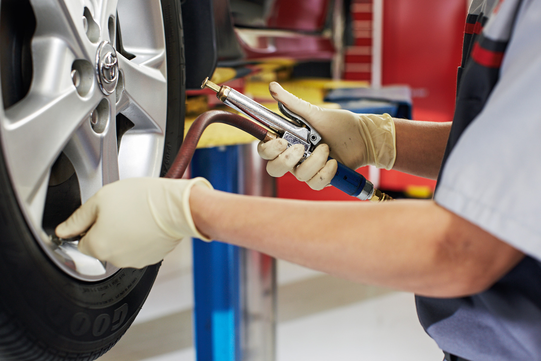How to check your tires' health at Tri County Toyota of Royersford | Technician pumping air into tire