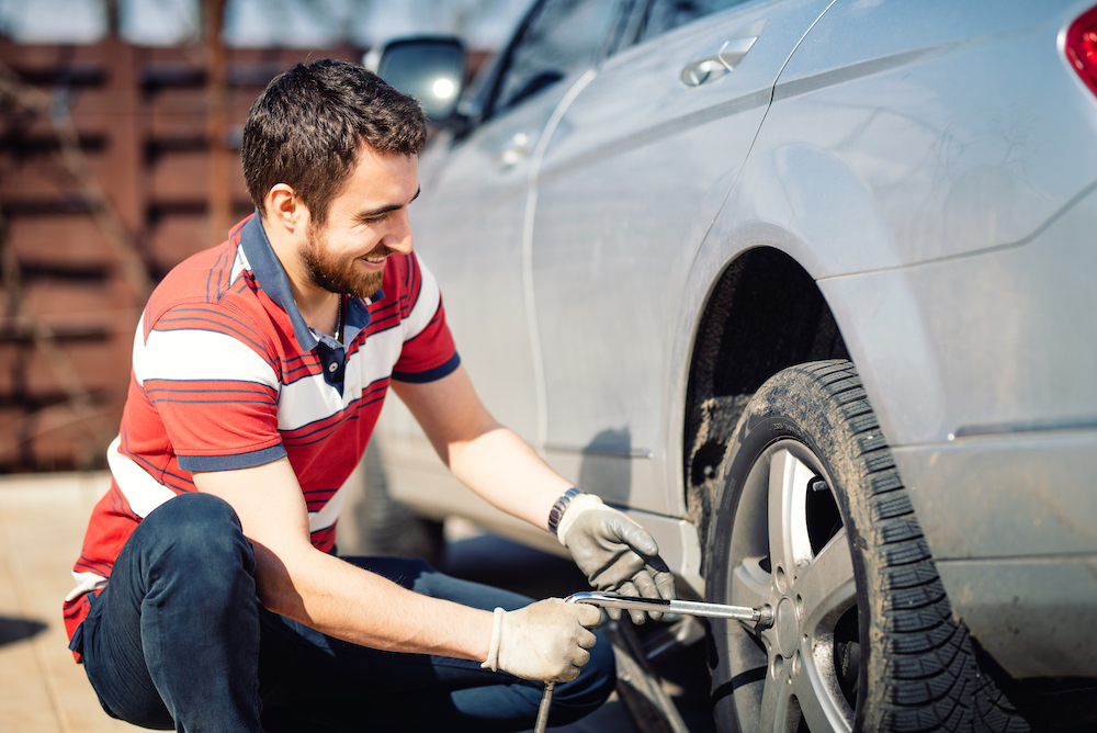 How to change a tire step-by-step guide at Tri County Toyota in Royersford | Man changing car tire