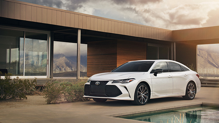 when to trade in your vehicle at Superior Toyota in Erie | White 2019 camry parked Outside a building