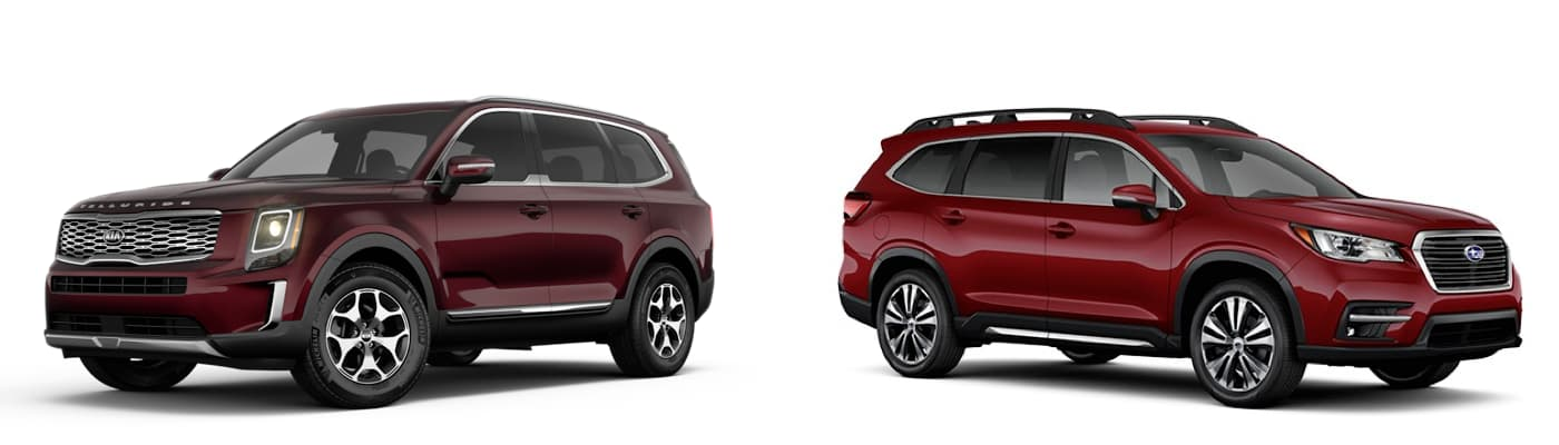 A burgundy 2020 Kia Telluride is facing left next to a red 2020 Subaru Ascent facing right.
