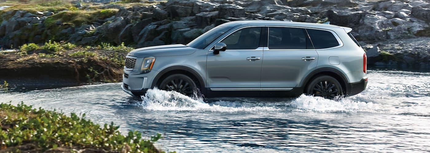 A silver 2020 Kia Telluride is crossing a river on a trail outside of Allentown, PA.