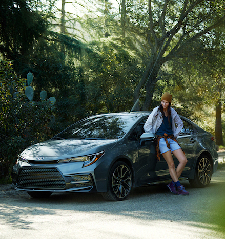 Compare the 2020 Honda Civic Sedan vs. the 2020 Toyota Corolla at Tri County Toyota of Royersford | Woman leaning on the 2020 Corolla