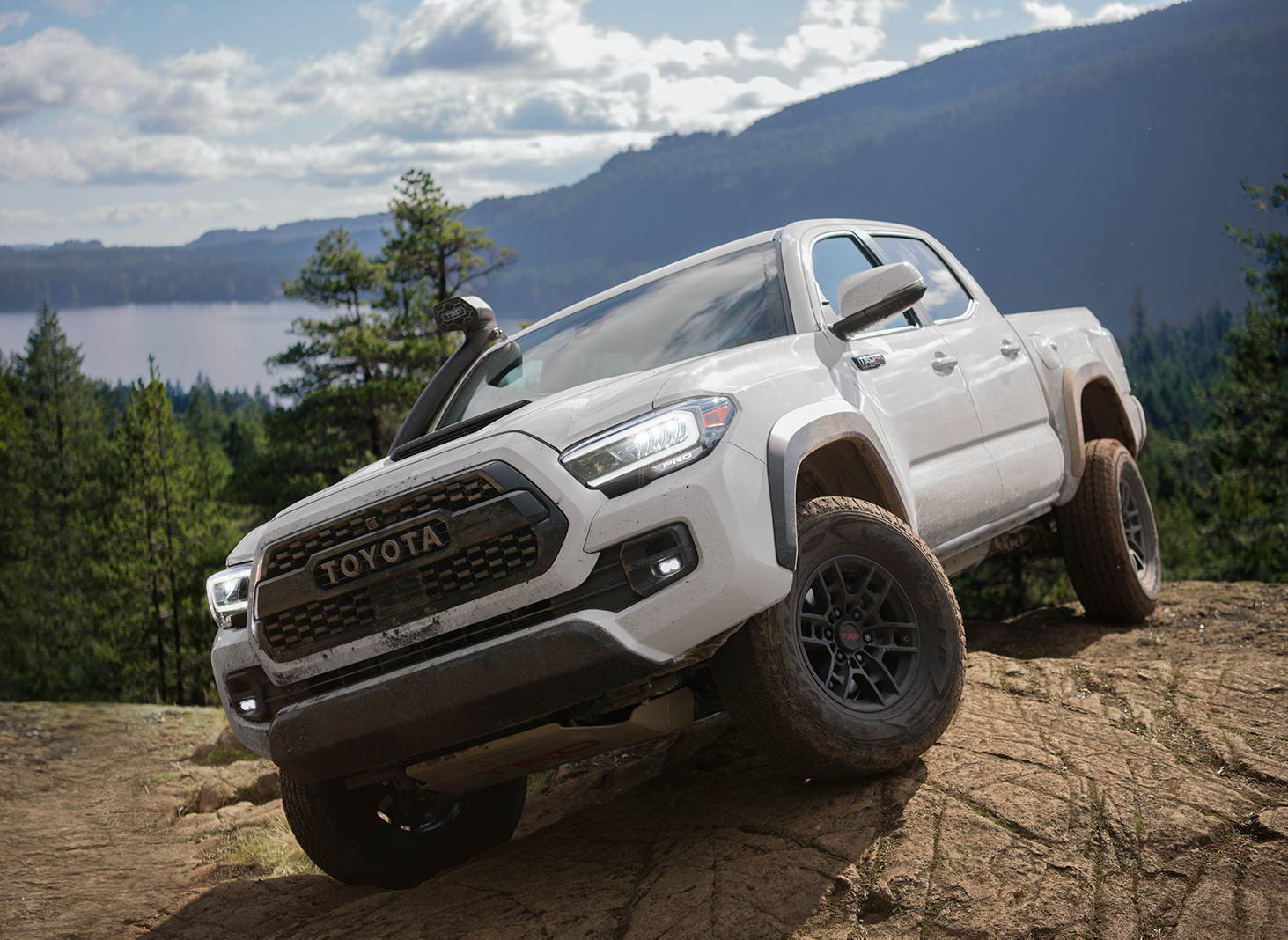 Model Features of the 2020 Toyota Tacoma at Tri County Toyota in Royersford | White 2020 Tacoma on top of a cliff