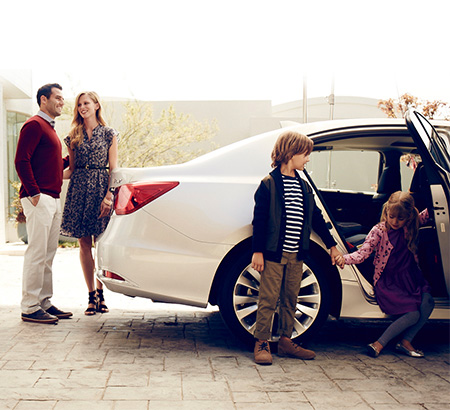 Family getting in to Acura Vehicle