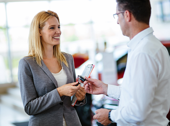 car trade in tax credit at Tri County Toyota in Royersford | Man handing woman car key