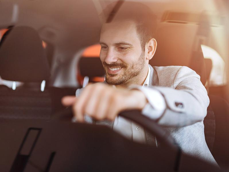Businessman checking out interior of a car