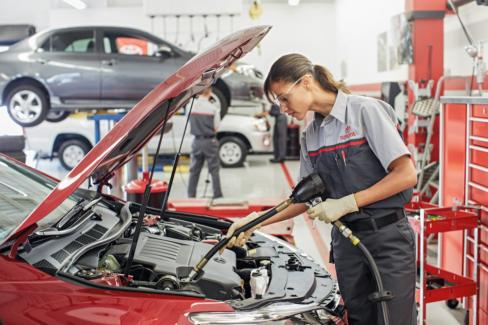 ToyotaCare in Erie at Superior Toyota | Toyota technicians checking car engine