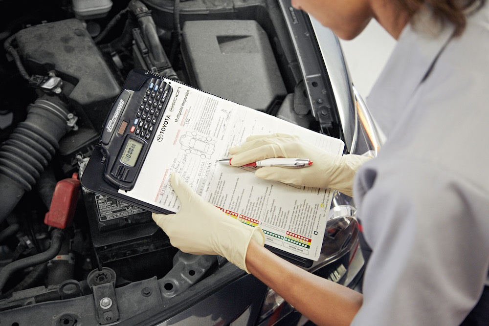 ToyotaCare in Erie at Superior Toyota | Toyota technicians doing multipoint inspection