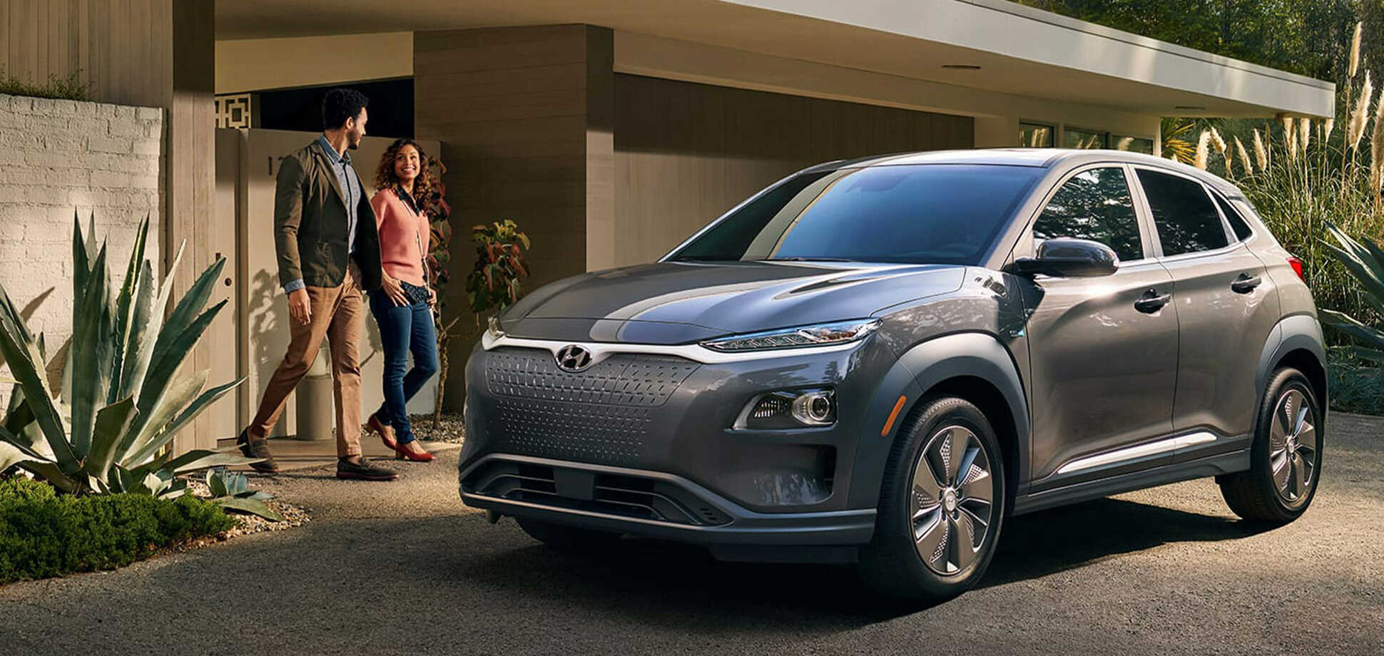 2019 Hyundai Kona EV parked in front of house