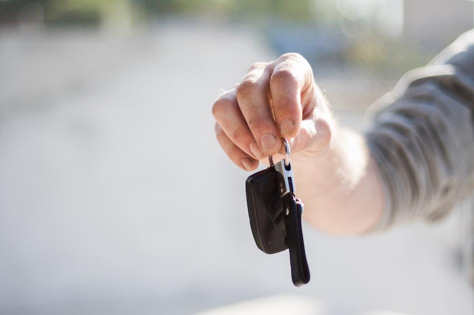 A hand dangling a set of car keys