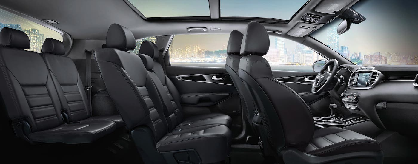 The three rows of seats in a 2020 Kia Sorento is shown from the side.