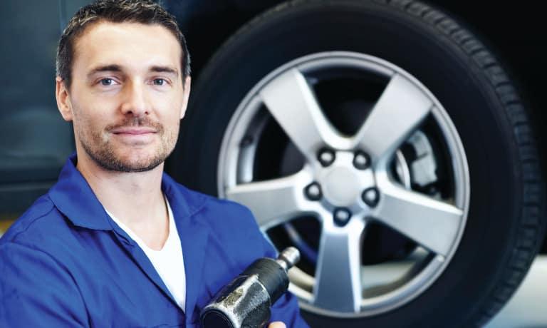 mechanic-working-on-car-tire