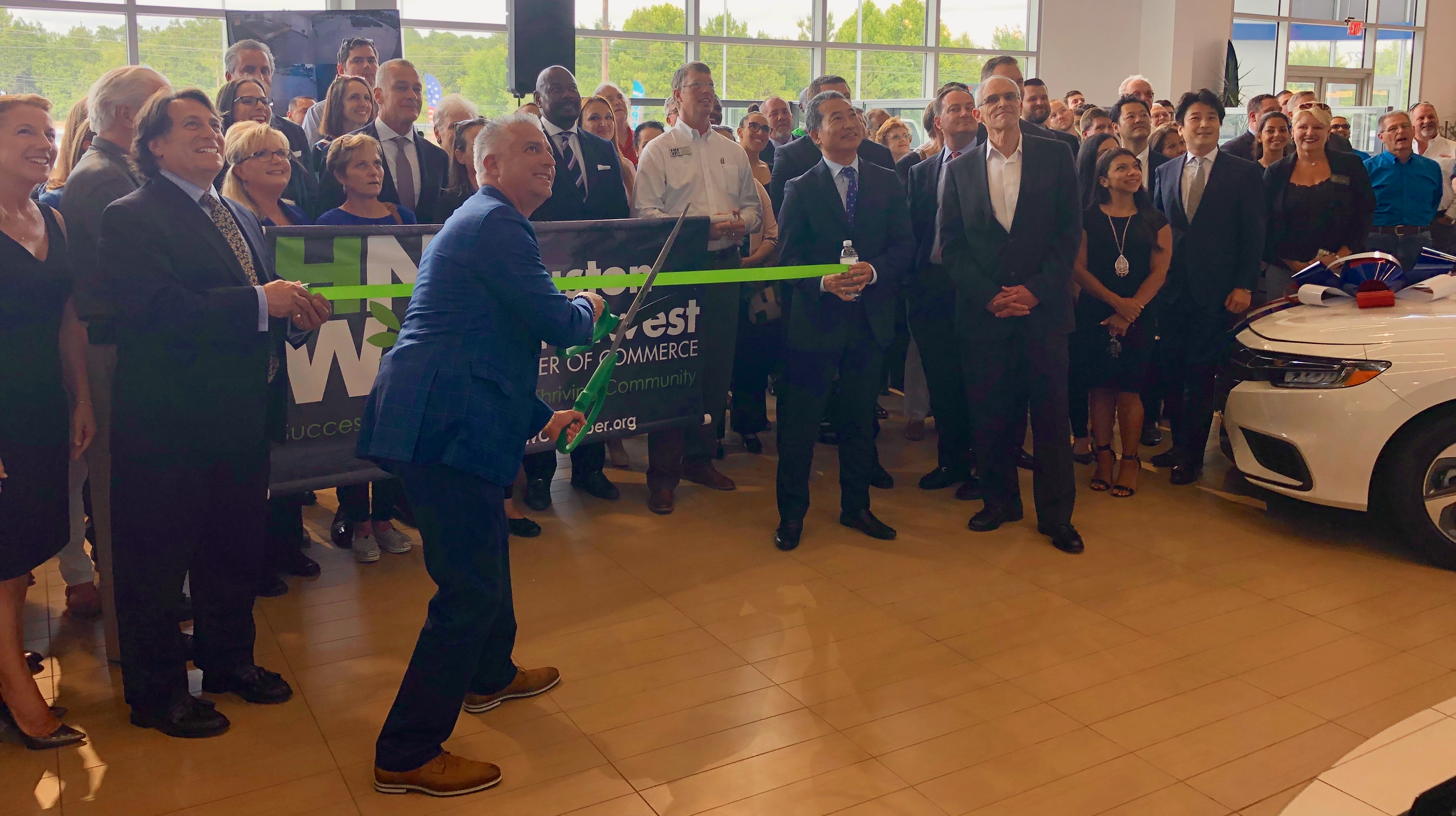 Honda of Tomball Grand Opening – Lenny Gonzales Cutting Ribbon