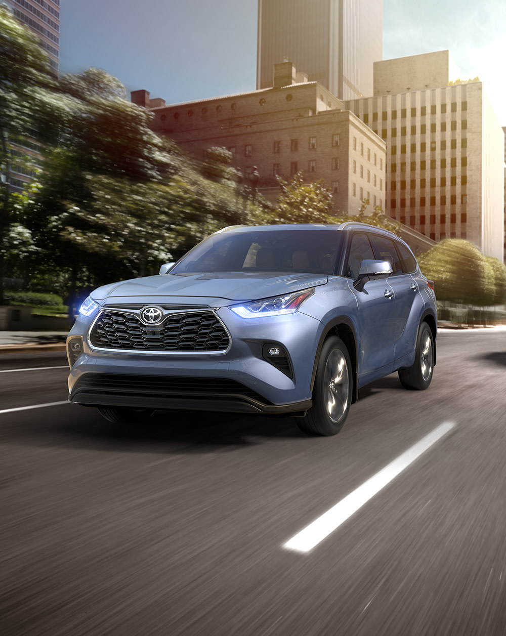 Comparison of the 2020 Toyota Highlander vs. the 2020 Honda Pilot at Tri County Toyota of Royersford | The 2020 Toyota Highlander Driving Through the City