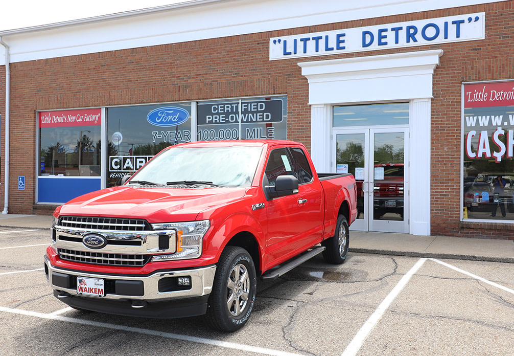 Picture of red Ford F-150 truck in front of car dealership Waikem Ford in Massillon, OH