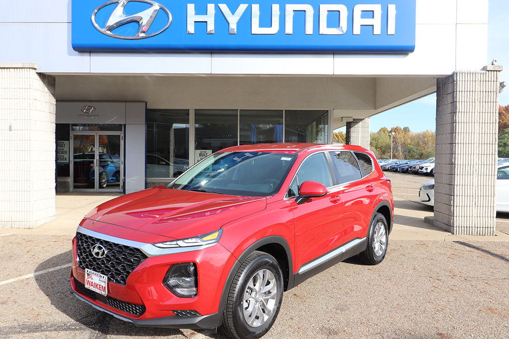 Picture of red Hyundai Kona in front of car dealership Waikem Hyundai in Massillon, OH