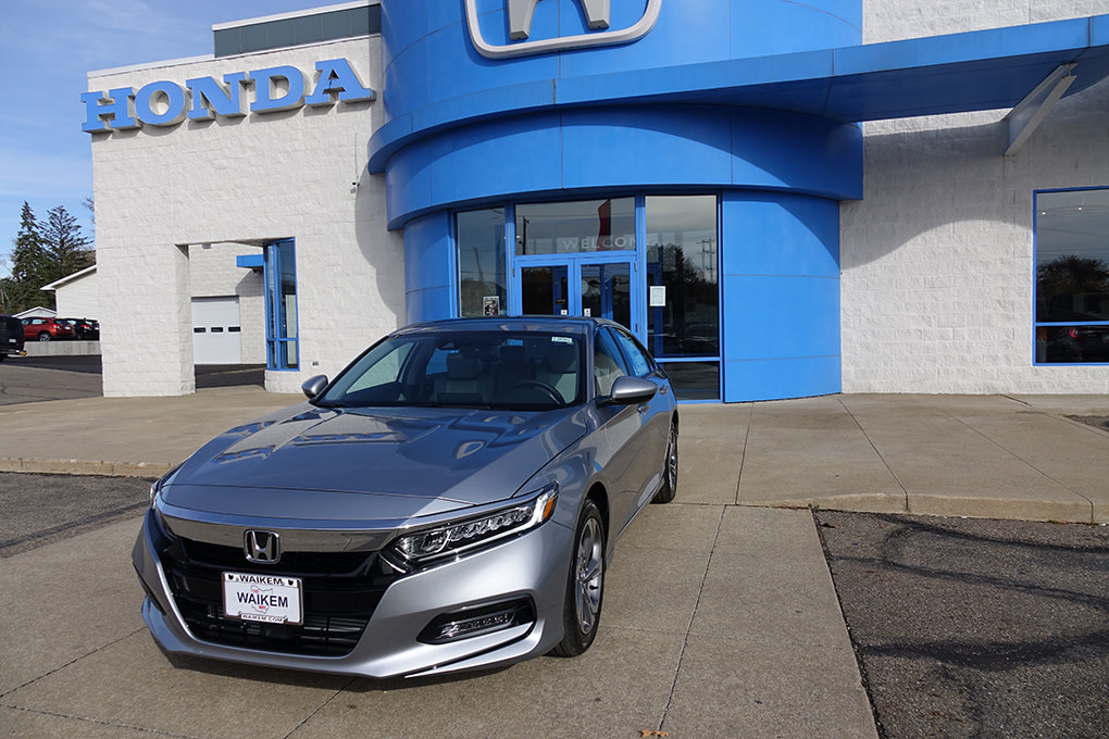 Picture of silver Honda Accord car in front of car dealership Waikem Honda in Massillon, OH