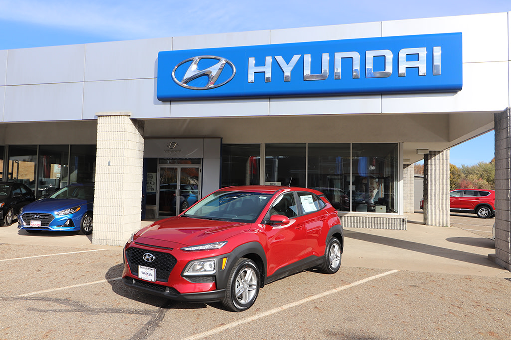 Picture of red Hyundai Kona SUV in front of car dealership Waikem Hyundai in Massillon, OH