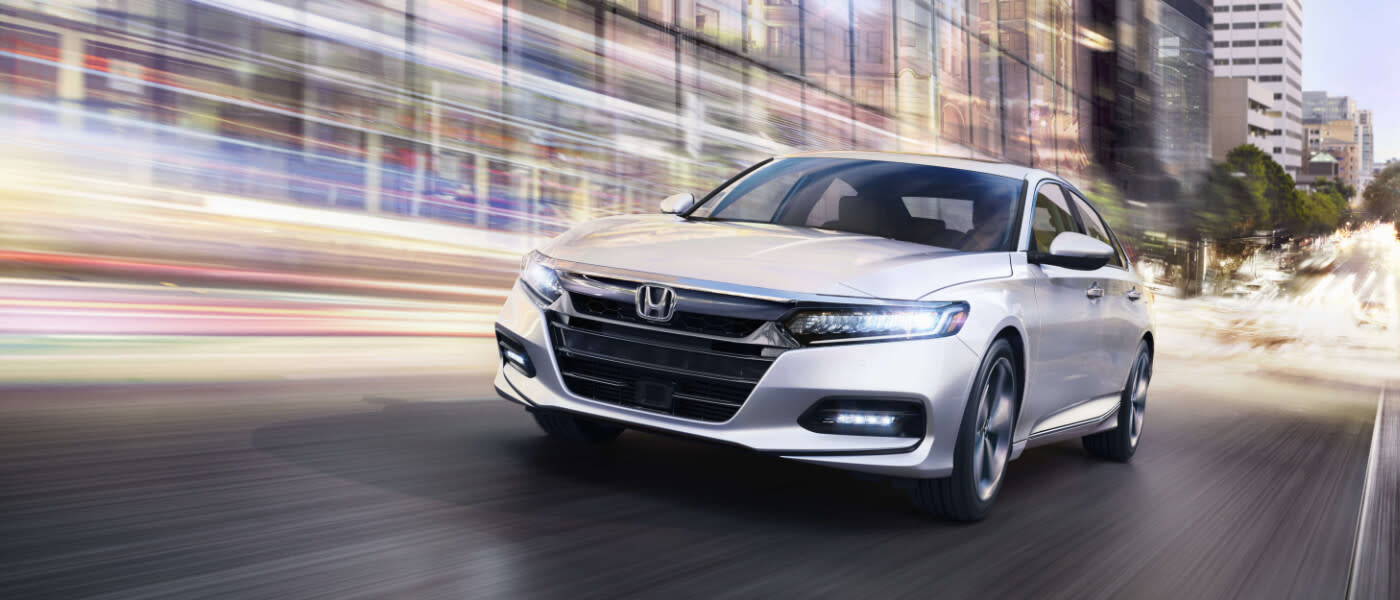 2019 Honda Accord driving in city with lightstreaks