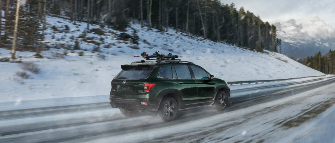2019 Honda Passport driving in the snow