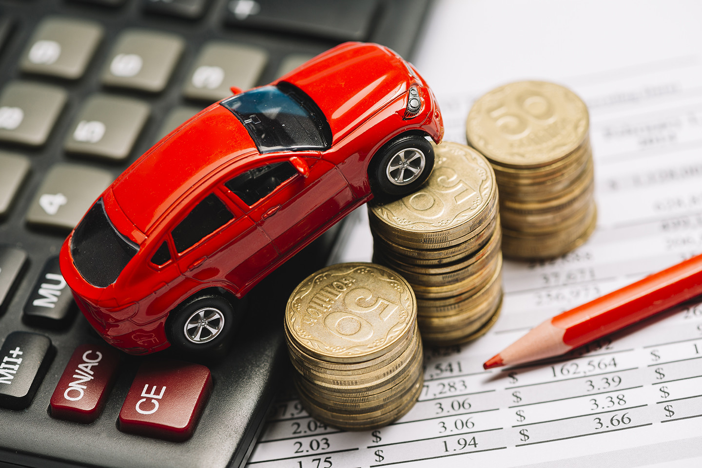 red toy car over finance papers