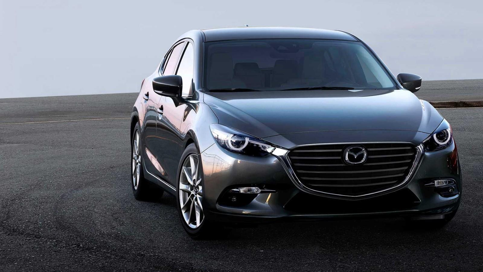 Mazda 3 Owners Manual: Rear Window Defogger