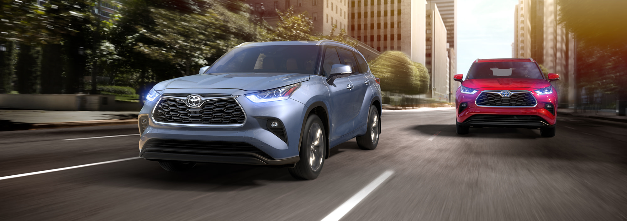 Comparison of the 2020 Toyota Highlander and the 2020 Kia Telluride at Tri County Toyota of Royersford | The 2020 Toyota Highlander and 2020 Toyota Highlander Hybrid Driving Through City