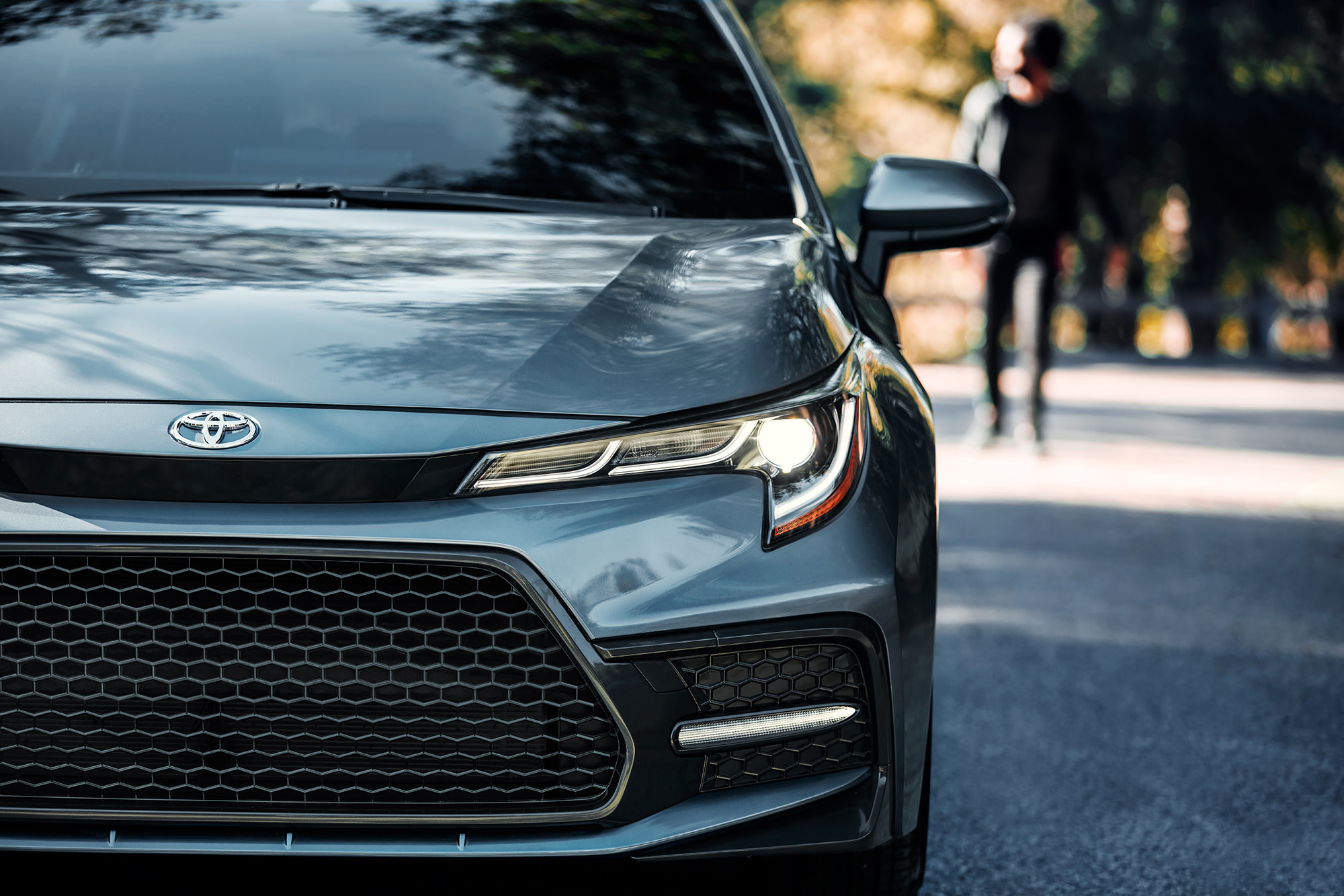 Team Toyota of Glen Mills is a Toyota Dealership near Kennett Square PA   Closeup of gray 2020 Toyota Corolla front view