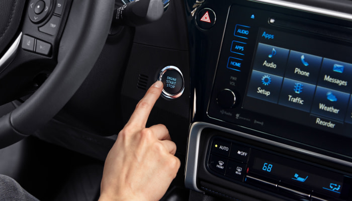 Touchscreen display and push button start inside the 2019 Toyota Corolla available at Uebelhor Toyota near French Lick, IN