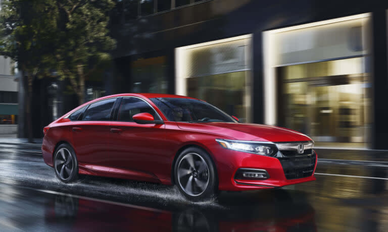 2019 Honda Accord driving on wet city street at night