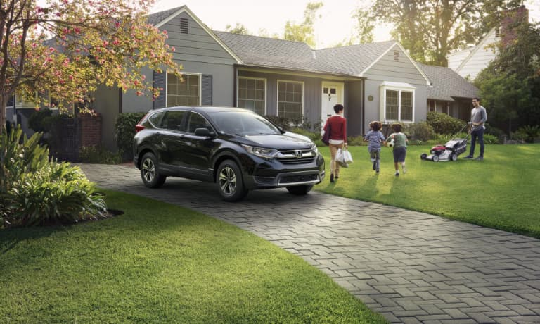 New Honda CR-V parked outside a house