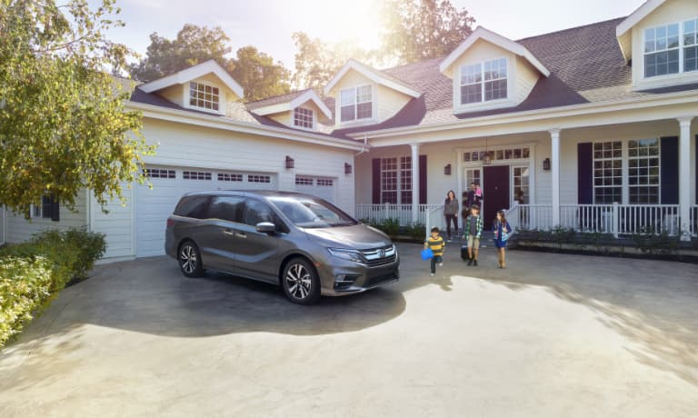 New Honda Odyssey parked at a family home
