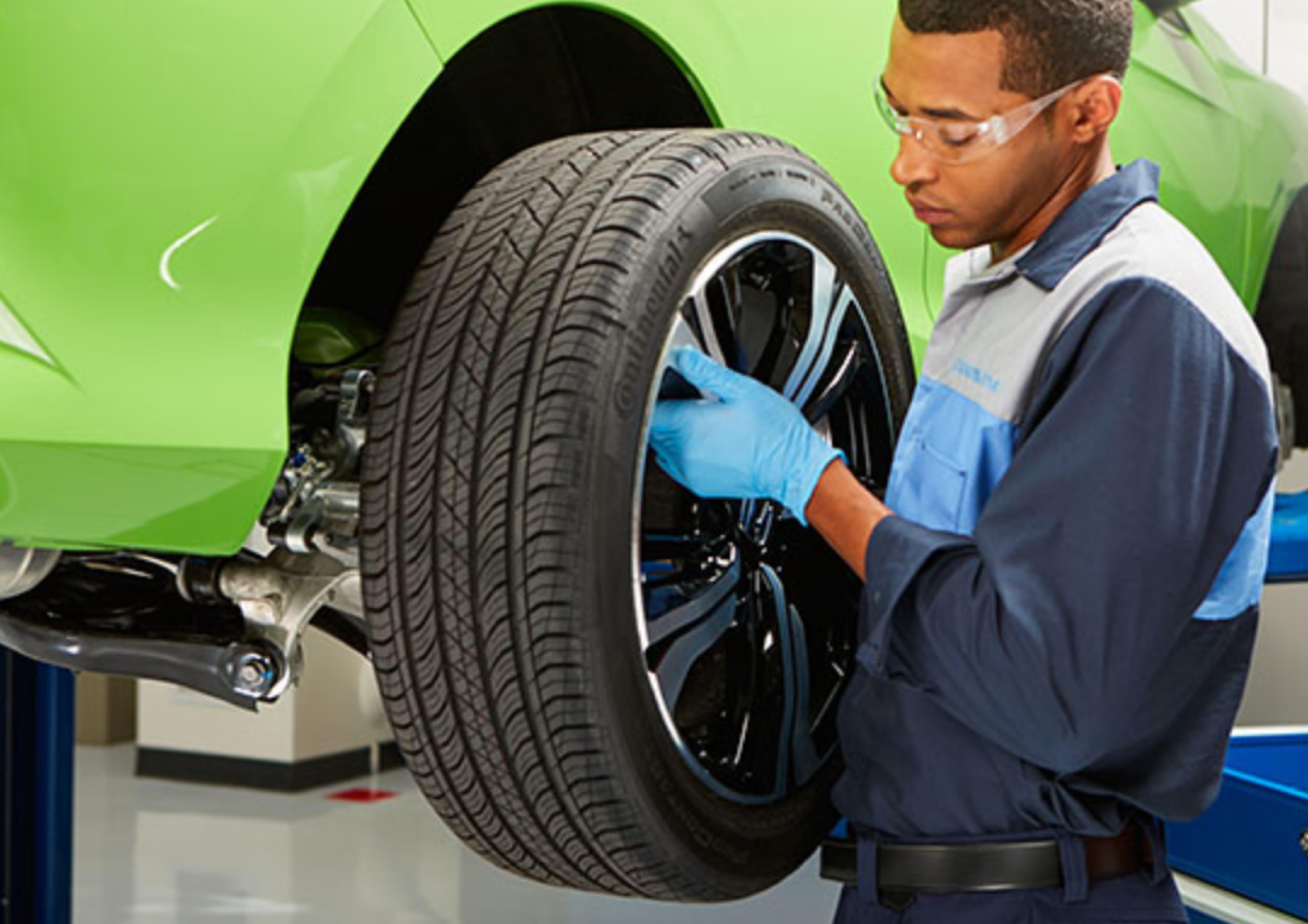 Man replacing tires in Missoula