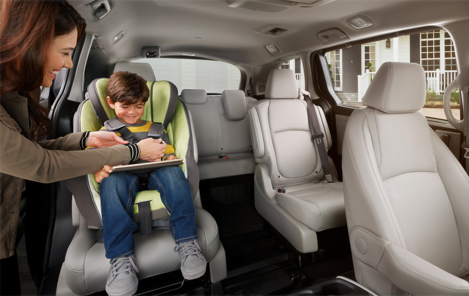 Child Being Buckled into Car Seat in Honda Element